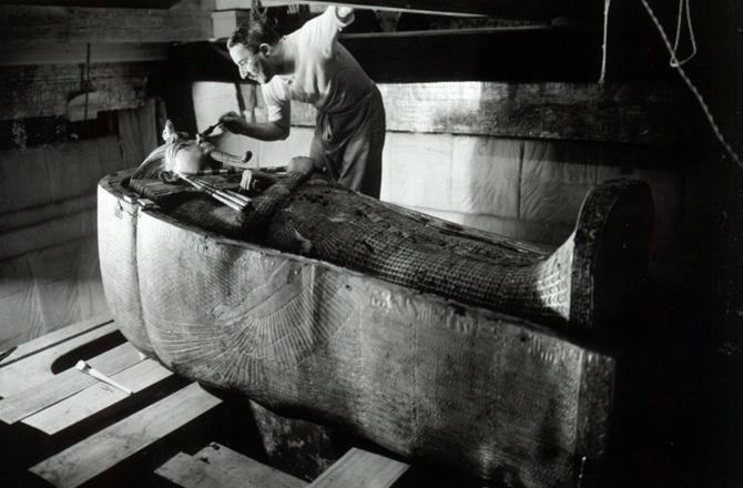 Howard Carter brushing dust off King Tut's mummy. NBC PHOTO: Harry Burton