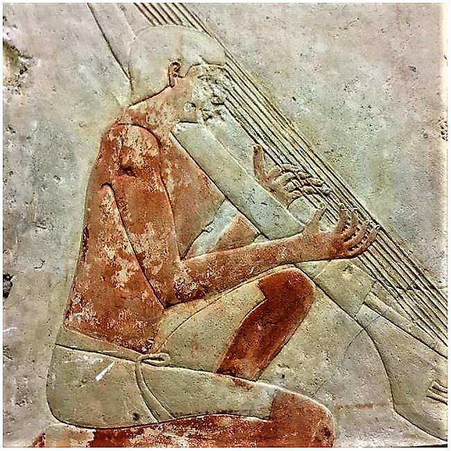 egyptian-man-playing-the-harp-0